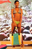 MEDELLIN -COLOMBIA-21-01-2014. Una modelo presenta una creacion de la marca multinacional de lycra durante la feria Colombiatex 2014, el 21 de enero de 2014 en Medellin, departamento de Antioquia, Colombia . A model presents a creation of the multinational brand Lycra during 2014 Colombiatex fair, January 21, 2014 in Medellin, Antioquia department, Colombia.<br />  Photo:VizzorImage / Luis Rios / Stringer