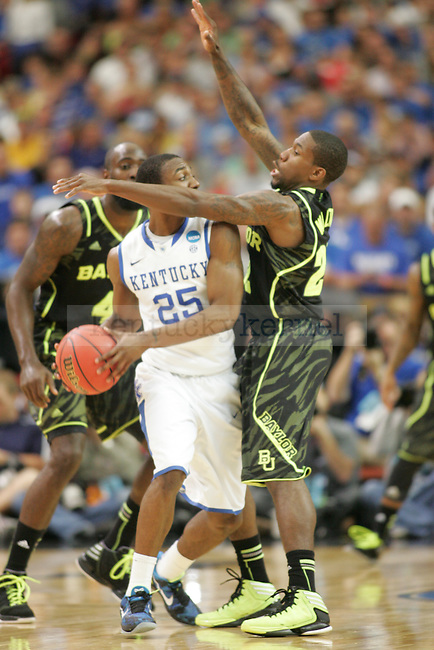 UK freshman point guard Marquis Teague is guarded by Baylor players during the second half of the UK vs. Baylor South Regional Finals at the Georgia Dome in Atlanta,  March 25, 2012. UK defeated Baylor 82-70. Photo by Brandon Goodwin   Staff