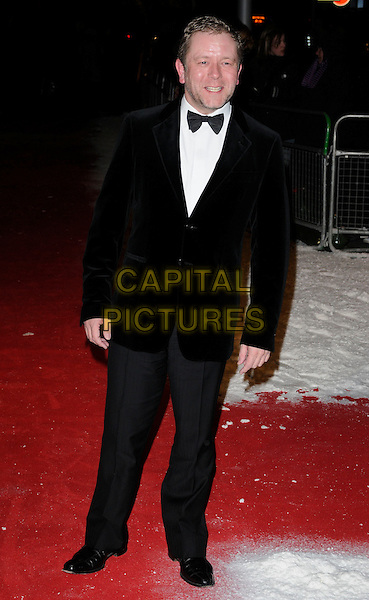 JON CULSHAW .At the Dickensian Ball, Harrods, Hans Crescent, Knightsbridge, London, December 1st 2010..full length black tuxedo tux bow tie .CAP/CAN.©Can Nguyen/Capital Pictures.