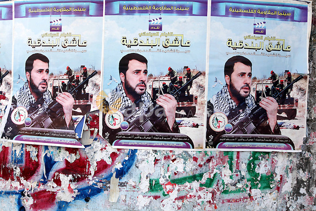 A picture for the leader in Izz al-Din al-Qassam, the military wing of hamas, the martyr Awad Silmi, on a poster invites Palestinians to view a cinema movie about his life, in Gaza city, on Aug 28, 2012. Hamas prepare to show a series about the life of Hamas leader Sheikh Ahmed Yaseen next Ramadan. Photo by Majdi Fathi