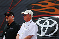 Mar 29, 2014; Las Vegas, NV, USA; Toyota official Keith Dahl  (left) and NHRA official Graham Light during qualifying for the Summitracing.com Nationals at The Strip at Las Vegas Motor Speedway. Mandatory Credit: Mark J. Rebilas-