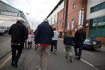 Sheffield United 2 Leeds United 0, 19/03/2011. Bramall Lane, Championship. Sheffield United supporters making their way past the John Street Stand at the club's Bramall Lane ground prior to the Npower Championship fixture against Leeds United. The home team won the game by two goals to nil watched by a crowd of 23,728. Bramall Lane is the world's oldest professional football ground and at one time hosted both football and cricket. Photo by Colin McPherson.