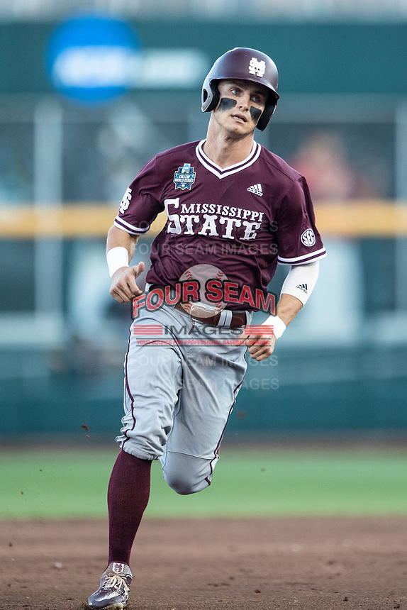 Mississippi State Bulldogs outfielder Jake Mangum (15) runs to third base during Game 10 of the NCAA College World Series against the Louisville Cardinals on June 20, 2019 at TD Ameritrade Park in Omaha, Nebraska. Louisville defeated Mississippi State 4-3. (Andrew Woolley/Four Seam Images)