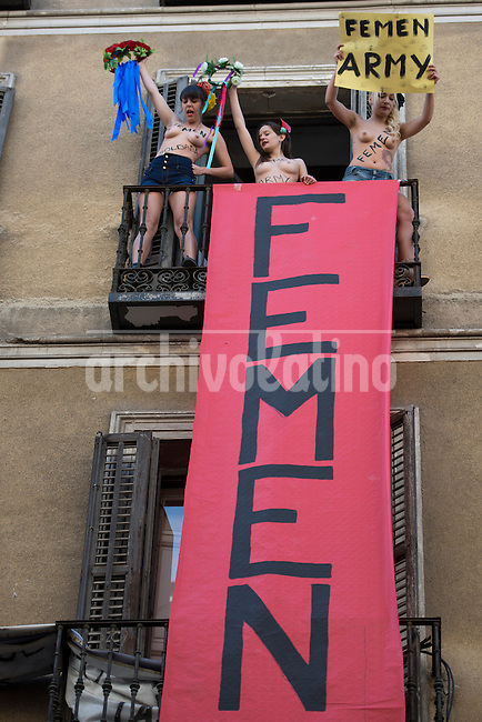 Faminist of Femen organization perform a sextremism demonstration to call attention on genre violence and inquality between sexs, in Madrid, Spain.