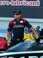 Sep 13, 2013; Charlotte, NC, USA; Crew member for NHRA top fuel dragster driver Billy Torrence during qualifying for the Carolina Nationals at zMax Dragway. Mandatory Credit: Mark J. Rebilas-