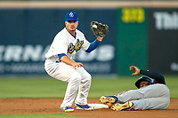 Rancho Cucamonga Quakes shortstop Omar Estevez (21)  tags out Lake Elsinore Storm Eguy Rosario (1) as he attempts to steal second base at LoanMart Field on April 20, 2018 in Rancho Cucamonga, California. The Quakes defeated the Storm 7-5.  (Donn Parris/Four Seam Images)