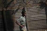 JOHANNESBURG, SOUTH AFRICA - JULY 13: A boy walks along the street in Soweto on July 13, 2006, in Johannesburg, South Africa. (Photo by Landon Nordeman)..