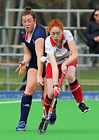 Action from the 2017 Jenny Hair Cup girls hockey match between Horowhenua College (white and red) and New Plymouth Girls' High School (navy) at Hockey Manawatu Twin Turfs in Palmerston North, New Zealand on Wednesday, 6 September 2017. Photo: Dave Lintott / lintottphoto.co.nz