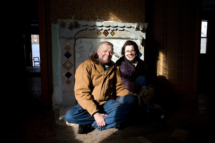 Court and Karen Conn inside their historic Maisenbacher house, which is believed to have been built with the help of $650 that Isaac Lindsay borrowed from Abraham Lincoln. The Conns purchased the home in 2006 when the building was at risk to make room for a parking lot.