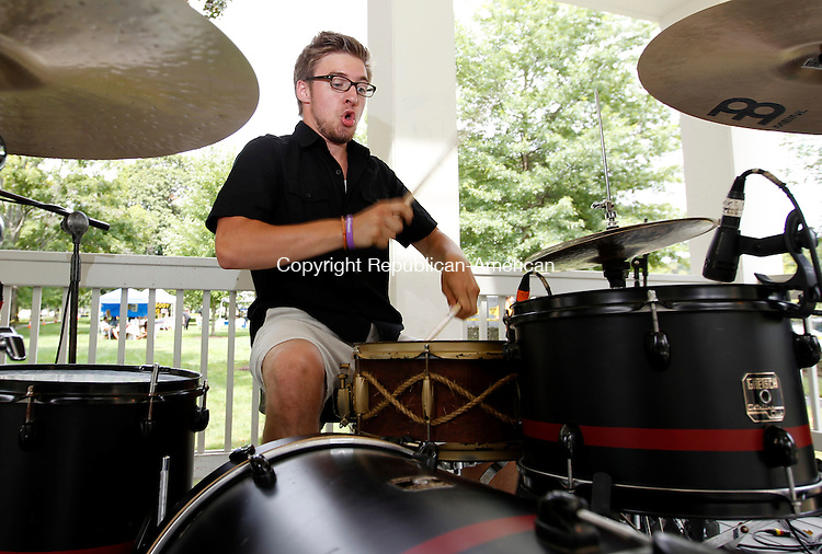 """Southbury, CT- 13, August 2011-081311CM04 Jack Hein of Seymour, jams on the drums during The Local Musicians Collaborative Saturday afternoon at the Green Shopping Center in Southbury.  Hein and his group, """"Cinema24"""" were among 12 bands who performed at the charity event.  The net proceeds will benefit the Cystic Fibrosis Foundation.  Christopher Massa Republican-American"""