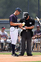 GCL Yankees 2 manager Pat Osborn (54) makes a pitching change with umpire J.C. Velez during a game against the GCL Braves on June 23, 2014 at the Yankees Minor League Complex in Tampa, Florida.  GCL Yankees 2 defeated the GCL Braves 12-4.  (Mike Janes/Four Seam Images)