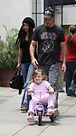 5-30-09 .Exclusive.Kevin Dillon playing with his baby daughter Ava pushing her in .a tricycle with wife Jane Stuart in Los Angeles california...AbilityFilms@yahoo.com.805-427-3519.www.AbilityFilms.com.