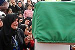 CHAMCHAMAL, IRAQ: A woman weeps during the funeral ceremony of 104 Kurds discovered in a mass grave...On April 15, 2010, Iraqi Kurds held a ceremony to honor the 102 children and 2 pregnant women discovered in a mass grave near the town of Dibis.  They are believed to have been killed in the 1988 Anfal genocidal campaign against Iraq's Kurds.