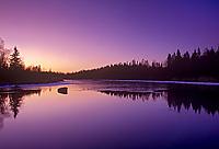 Reflection at dawn in Whiteshell River, Whiteshell Provincial Park, Manitoba, Canada