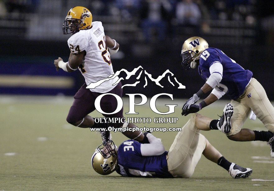 November 08, 2008:   Arizona State running back #24 Keegan Herring fights to brake the tackle of Washington safety Tripper Johnson.  Arizona State defeated Washington 39-19  at Husky Stadium in Seattle, Washington.
