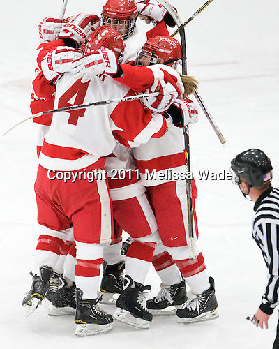 Kathryn Miller (BU - 4), Marie-Philip Poulin (BU - 29), Jenelle Kohanchuk (BU - 19) - The Boston University Terriers defeated the visiting Mercyhurst College Lakers 4-2 in their NCAA Quarterfinal matchup on Saturday, March 12, 2011, at Walter Brown Arena in Boston, Massachusetts.