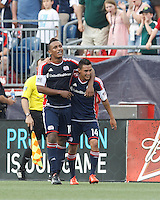 New England Revolution midfielder Diego Fagundez (14) celebrates his goal with teammates.  In a Major League Soccer (MLS) match, the New England Revolution (blue) defeated LA Galaxy (white), 5-0, at Gillette Stadium on June 2, 2013.