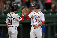 Right fielder Jarren Duran (35) of the Greenville Drive is greeted by Ryan Fitzgerald (24) after scoring a run during a game against the Lexington Legends on Sunday, September 2, 2018, at Fluor Field at the West End in Greenville, South Carolina. Greenville won, 7-4. (Tom Priddy/Four Seam Images)