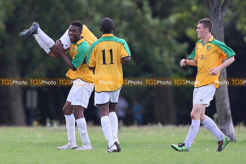 Bancroft celebrate their second goal - Bancroft United (yellow) vs Albion Manor - Hackney & Leyton League Football at Victoria Park - 12/09/10 - MANDATORY CREDIT: Gavin Ellis/TGSPHOTO - SELF-BILLING APPLIES WHERE APPROPRIATE. NO UNPAID USE. TEL: 0845 094 6026