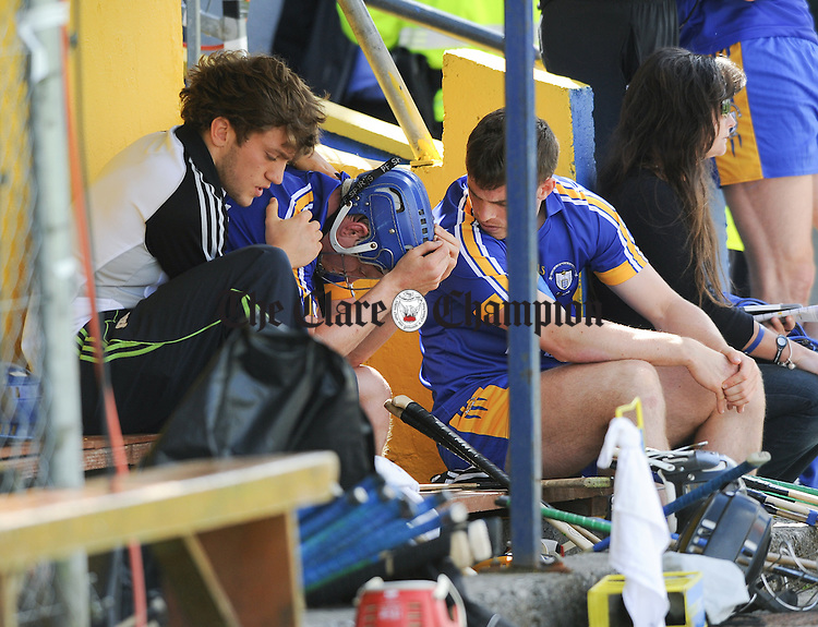 A clearly disappointed Podge Collins of Clare is comforted by team mates Shane O Donnell and his brother Sean in the dugout after being red carded by referee Cathal Mc Allister during their All-Ireland qualifier game against Wexford at Cusack Park. Photograph by John Kelly.