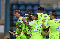 Goalscorer Chris Porter (left) of Colchester United celebrates his goal with teammates during the Sky Bet League 2 match between Wycombe Wanderers and Colchester United at Adams Park, High Wycombe, England on 27 August 2016. Photo by Andy Rowland.