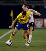Heather O'Reilly (9) of the USWNT fights for the ball Therese Sjogran (15) of Sweden at Rentschler Field in East Hartford, Connecticut.  The USWNT defeated Sweden, 3-0.