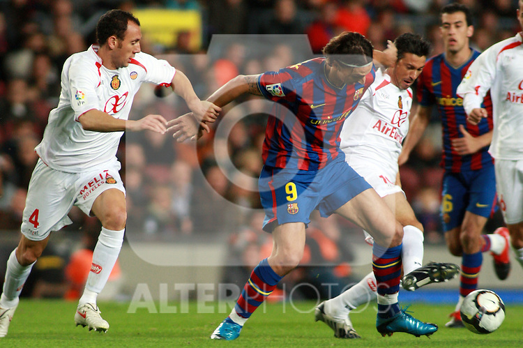 Football Season 2009-2010. Barcelona's player Zlatan Ibrahimovic (C) and Mallorca's player Marti (R) and Ramis (L) during the Spanish first division soccer match at Camp Nou stadium in Barcelona November 07, 2009.