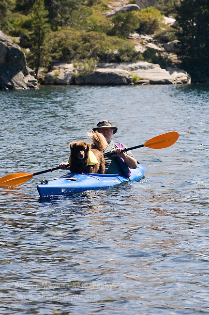 Man and his dog kayaking Lake Faucherie