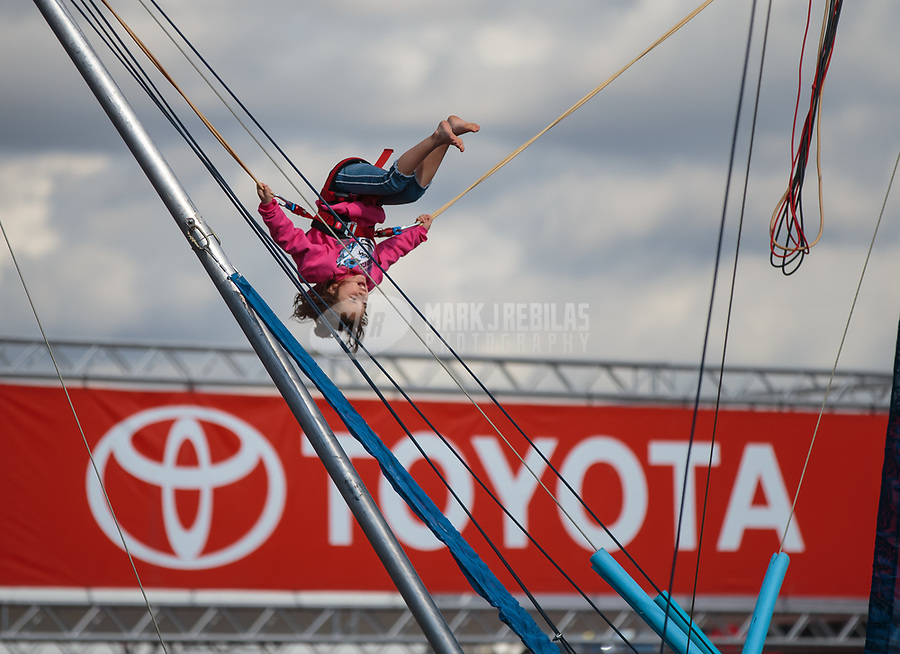 Feb 9, 2019; Pomona, CA, USA; A young NHRA fan rides a ride near the Toyota hospitality display on the midway during qualifying for the Winternationals at Auto Club Raceway at Pomona. Mandatory Credit: Mark J. Rebilas-USA TODAY Sports