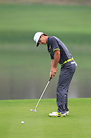 Thobjorn Olesen (DEN) putts on the 11th green during Friday's Round 2 of the 2014 BMW Masters held at Lake Malaren, Shanghai, China 31st October 2014.<br /> Picture: Eoin Clarke www.golffile.ie