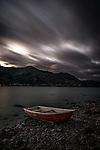 A small rowboat on the shore of Roy's Bay in Lake Wanaka, New Zealand