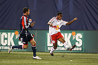New York Red Bulls midfielder Danleigh Borman (12) crossers the ball in front of New England Revolution defender Jay Heaps (6). The New York Red Bulls and the New England Revolution played to a 1-1 tie during a Major League Soccer match at Giants Stadium in East Rutherford, NJ, on April 19, 2008.