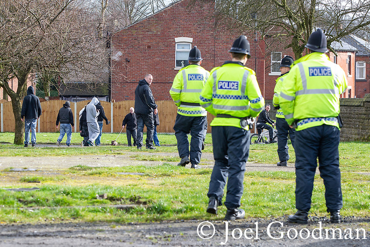 © Joel Goodman - 07973 332324 . 03/03/2012 . Heywood , UK . Police chase after demonstrators as they disperse in Heywood town centre after the National Front hold a rally in protest against an alleged paedophile ring that had been operating in the area . There is currently (3rd March 2012) a case being tried at Liverpool Crown Court in relation to the allegations . Last Thursday (23rd February 2012) a protest organised in the town in relation to the same story resulted in Asian business being attacked by an angry mob . Photo credit : Joel Goodman