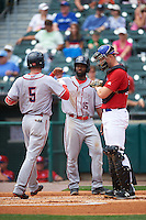 Syracuse Chiefs left fielder Brian Goodwin (15) congratulates Jason Martinson (5) after hitting a grand slam home run during a game against the Buffalo Bisons on July 31, 2016 at Coca-Cola Field in Buffalo, New York.  Buffalo defeated Syracuse 6-5.  (Mike Janes/Four Seam Images)