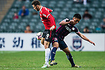 Muangthong United Forward Michael N'dri (l) trips up with SC Kitchee Li Hoi Ngai (r) during the 2017 Lunar New Year Cup match between SC Kitchee (HKG) vs Muangthong United (THA) on January 28, 2017 in Hong Kong, Hong Kong. Photo by Marcio Rodrigo Machado/Power Sport Images