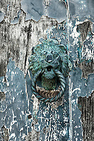 Rustic and worn door knock, Murano, Venice, Italy