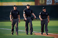 Umpires Mike Snover, Aaron Higgins, and Greg Roemer before an Eastern League game between the Richmond Flying Squirrels and Bowie Baysox on August 15, 2019 at Prince George's Stadium in Bowie, Maryland.  Bowie defeated Richmond 4-3.  (Mike Janes/Four Seam Images)