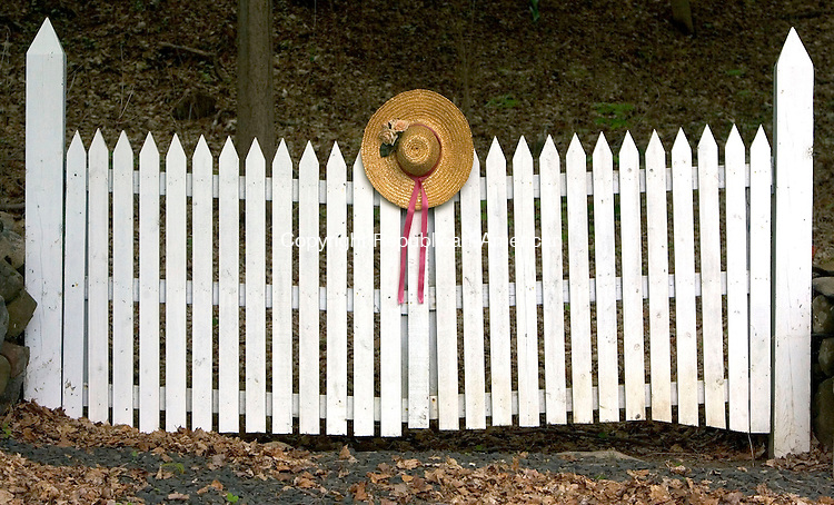 COUNTRYLIFE BANNER<br /> WOODBURY CT. 11 May 2015-051115SV05-A springtime hat hangs on a gate on Main Street South in Woodbury Monday.<br /> Steven Valenti Republican-American