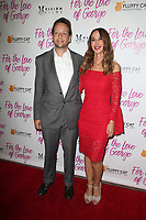 HOLLYWOOD, CA - February 12: Henry Hereford, Nadia Jordan, at Premiere Of Vision Films' 'For The Love Of George' at TCL Chinese 6 Theatres in Hollywood, California on February 12, 2018. Credit: Faye Sadou/MediaPunch