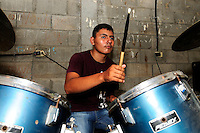 A member of the 'Music for Hope' youth project, rehearsing for a performance, led by music teacher Pedro Esquival Chavez from the community of Zamoran, El Salvador.