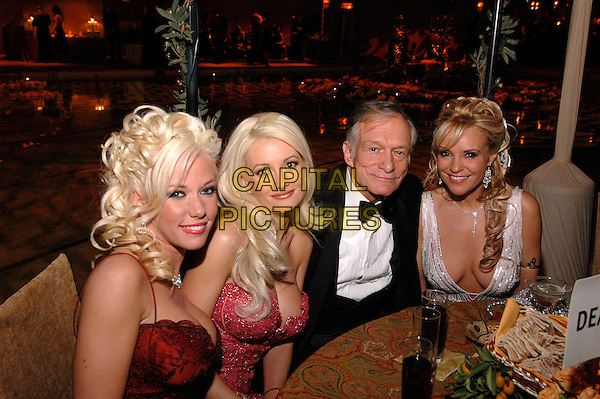 HUGH HEFNER.62nd Annual Golden Globe Awards, Beverly Hills, Los Angeles, California.January 16th, 2005.half length, sitting, girls, cleavage, playboy bunnies.www.capitalpictures.com.sales@capitalpictures.com.Supplied by Capital Pictures.