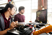 David Zhu, left, a senior mechanical engineering major from Clinton, and Brandon Powell, a computer science student from Columbia, work on the hard drive components for Mississippi State's &quot;Halo Project&quot; supercar at the Center for Advanced Vehicular Systems. The car, which features an on-board NVIDIA supercomputer, is a self-driving, all-electric sport utility vehicle.<br />  (photo by Beth Wynn / &copy; Mississippi State University)