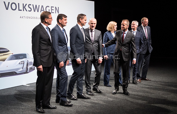 dpatop - 03 May 2018, Germany, Berlin: Herbert Diess (3.f.r.), the new CEOof Volkswagen AG, with colleagues at the Volkswagen AG annual general meetingat the Messegelaende in Berlin. Photo: Bernd von Jutrczenka/dpa /MediaPunch ***FOR USA ONLY***