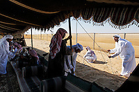 The Mohamed Khamisi compound where they meet a rival family for lunch and try to work out who is competing on which day.  This is one of the few families that have enough ! Mil Dir camels to compete in the group of 35 camels competition.