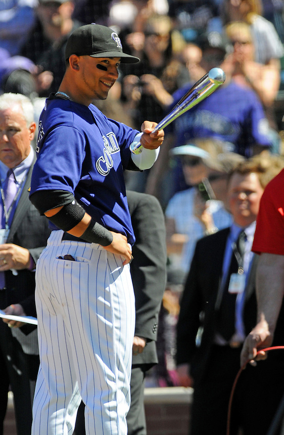 01 April 2011:   Colorado Rockies left fielder Carlos Gonzalez (5) smiles as he accepts his Louisville Slugger Silver Slugger award  during a regular season game between the Arizona Diamondbacks and the Colorado Rockies at Coors Field in Denver, Colorado. The Diamondbacks beat the Rockies 7-6 in 11 innings.    *****For Editorial Use Only*****