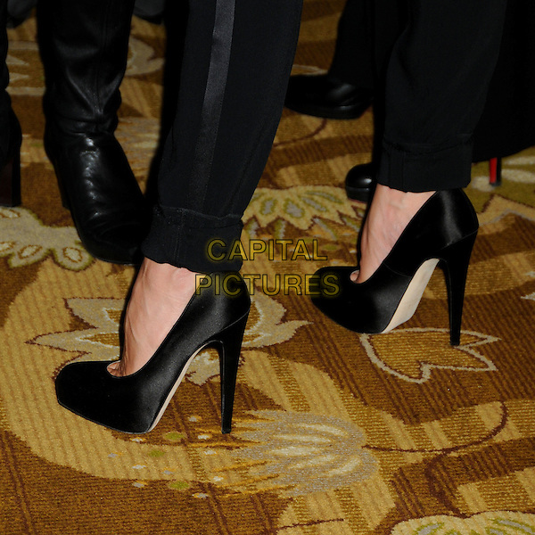 "VICTORIA BECKHAM's shoes .BritWeek 2010 Charity Event: ""Save The Children and Virgin Unite"" held at the Beverly Wilshire Hotel, Beverly Hills, California, USA, 22nd April 2010..detail silk satin  black feet high platform heels .CAP/ADM/BP.©Byron Purvis/AdMedia/Capital Pictures."