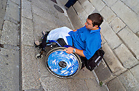 Wheelchair user finding it extremely difficult due to the high kerb. This image may only be used to portray the subject in a positive manner..©shoutpictures.com..john@shoutpictures.com