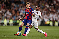 1st March 2020; Estadio Santiago Bernabeu, Madrid, Spain; La Liga Football, Real Madrid versus Club de Futbol Barcelona; Ivan Rakitic (FC Barcelona) holds off Vinicius Junior (Real Madrid)