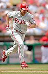11 June 2006: David Bell, third baseman for the Philadelphia Phillies, runs to first during a game against the Washington Nationals at RFK Stadium, in Washington, DC. The Nationals shut out the visiting Phillies 6-0 to take the series three games to one...Mandatory Photo Credit: Ed Wolfstein Photo..