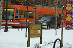 Portland streetcar in the snow at Jamison Square.